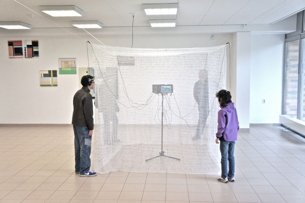 Mosquito Net Writings   Installation with 4 video monitors   exhibition: Exotika 2013 SAL Bangkok + Galerie M   Berlin 2013