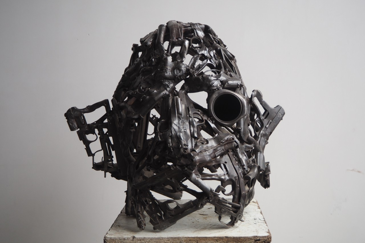 Helmet sculpture from real weapons from the War