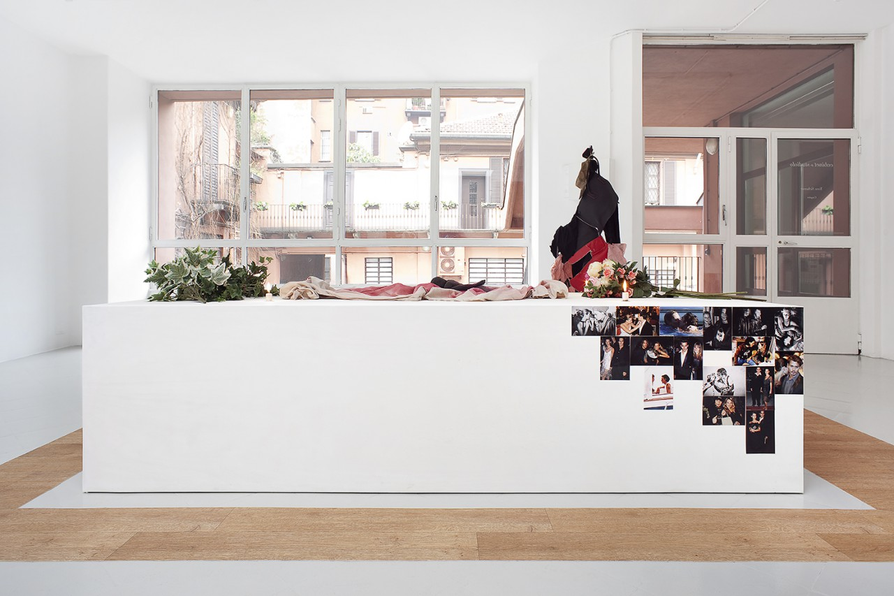 Altar, 2015 / Plinth, Cloth, Figure, Fake Flowers, Candles, Photographs; 250 x 110 x 65 cm (Plinth) 380 x 200 cm (outside)