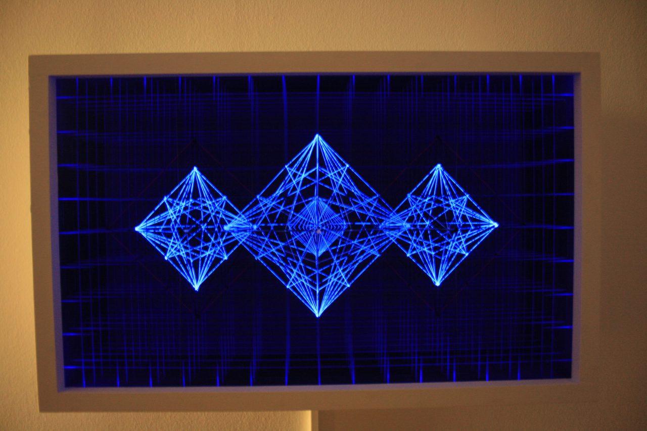 """Prisma X9"", 2016, cotton,nails, uv-light, private museum 50x80x26,5 cm"