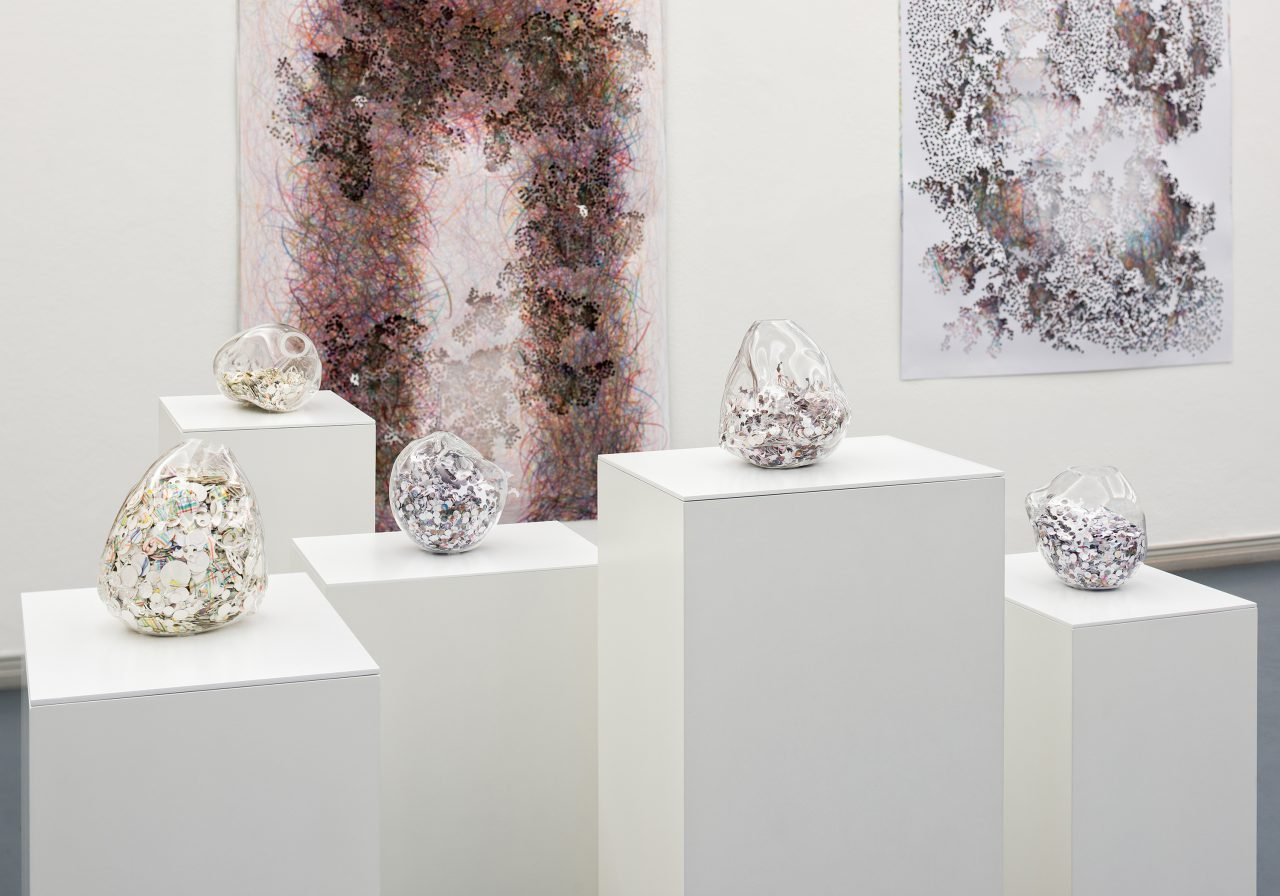 Proxy 4, 2015, punched-out papers from the series Proxy in a glass container, five works, each approx. 18 x 15 x 16 cm, Photo: Bernd Hiepe