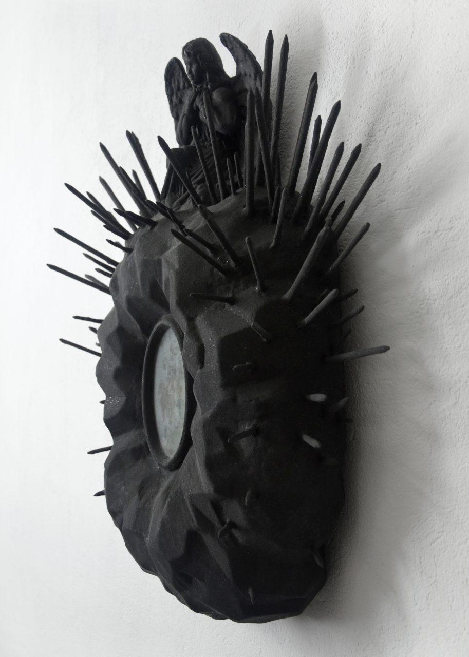 """Schrein"" – ""shrine"", 2012, rigid foam, putty, nails, ceramic, wood, glass, artificial flowers, dirt, rusty can, acrylic, glimmer, iridescent pigments, 61 x 51 x 17 cm"