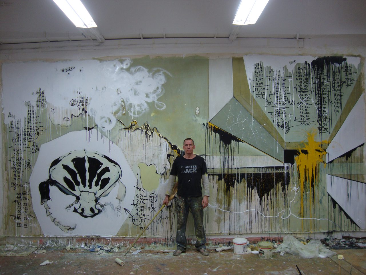Alexei Kostroma at his studio in Berlin with the painting