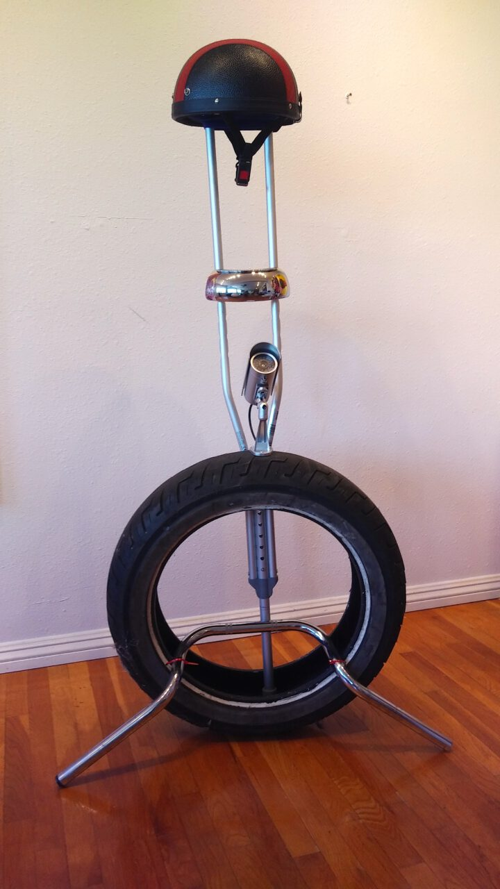 STAND. 2021. tire, crutch, handlebars, security camera, zip ties. 56 x 31 x 20 inches
